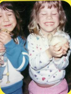 Carrie and me holding chicks (i'm guessing I'm about Lil's age)