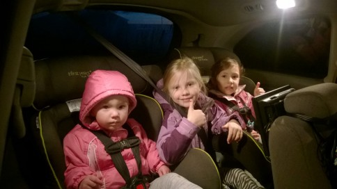 the girls are in the back of the van and ready to go swimming